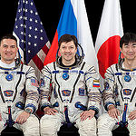 JSC2015E053687 (04/30/2015) --- Expedition 44 crew members NASA astronaut Kjell Lindgren (left), Russian cosmonaut Oleg Kononenko (center) and Japan Aerospace Exploration Agency (JAXA) astronaut Kimiya Yui.