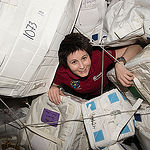 ISS043E159309 (05/04/2015) --- ESA (European Space Agency) astronaut Samantha Cristoforetti glides through supply containers packed onboard the International Space Station.