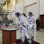 CG4G8721 --- (6 May 2015) --- At the Gagarin Cosmonaut Training Center in Star City, Russia, Expedition 44/45 backup Flight Engineer Timothy Kopra of NASA signs in for the first of two days of qualification exams May 6 as his crewmates, Yuri Malenchenko o