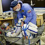 In the Integration Facility at the Baikonur Cosmodrome in Kazakhstan, Expedition 44 crew member Kjell Lindgren of NASA undergoes a pressure and leak check of his Sokol launch and entry suit July 11 as part of a fit check dress rehearsal. Lindgren, Oleg Kononenko of the Russian Federal Space Agency (Roscosmos) and Kimiya Yui of the Japan Aerospace Exploration Agency will launch July 23, Kazakh time from Baikonur in their Soyuz TMA-17M spacecraft for a five-month mission on the International Space Station. Credit: Gagarin Cosmonaut Training Center