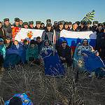 Expedition 37 Crew Members Sit Outside the Soyuz Capsule