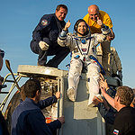 Expedition 43 commander Terry Virts of NASA is helped out of the Soyuz TMA-15M spacecraft just minutes after he and cosmonaut Anton Shkaplerov of the Russian Federal Space Agency (Roscosmos), center, and Italian astronaut Samantha Cristoforetti from Europ