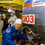 In the Integration Facility at the Baikonur Cosmodrome in Kazakhstan, Expedition 44 crewmember Oleg Kononenko of the Russian Federal Space Agency (Roscosmos) poses for pictures July 11 prior to entering his Soyuz TMA-17M spacecraft during a fit check dress rehearsal session. Kononenko, Kjell Lindgren of NASA and Kimiya Yui of the Japan Aerospace Exploration Agency will launch July 23, Kazakh time from Baikonur in their Soyuz TMA-17M spacecraft for a five-month mission on the International Space Station. Credit: Gagarin Cosmonaut Training Center