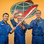 Expedition 38 Trio With Olympic Torch