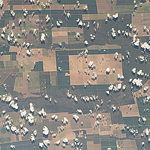 "ISS043E227213 (05/20/2015) --- Earth observation of South America from the International Space Station on May 20, 2015. NASA astronaut Terry Virts tweeted this image with the remark of: ""Farm fields in central #Brazil #SouthAmerica""."